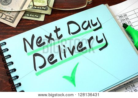 Next day delivery written on a notepad with marker.
