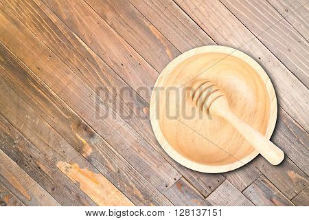 Wooden bowl and dipper on wood texture background, stock photo