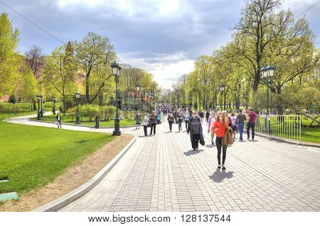MOSCOW RUSSIA - May 02.2016: Citizens and tourists stroll through the alleys of the Alexander Garden near the Kremlin