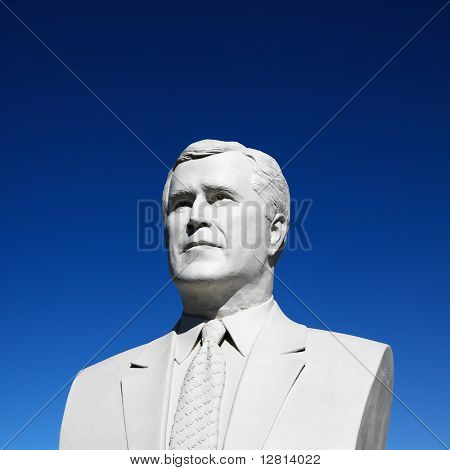 Bust of George Bush sculpture against blue sky in President's Park, Black Hills, South Dakota