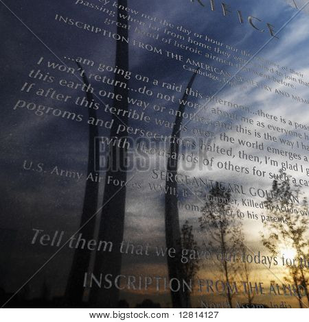 Three spires of Air Force Memorial reflected in marble engraved plaque in Arlington, Virginia, USA.