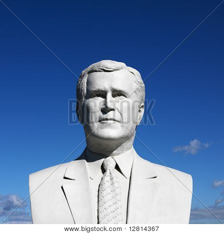 Bust of George Bush sculpture against blue sky in President's Park, Black Hills, South Dakota.