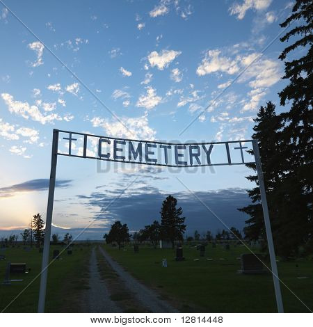 Sign over entrance to cemetary at dusk in rural South Dakota.
