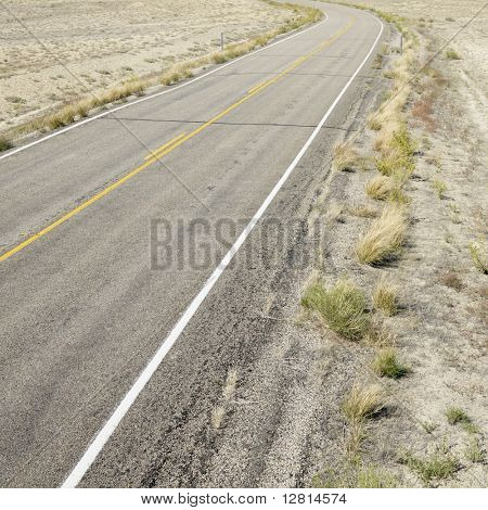 Road through barren landscape in Utah.