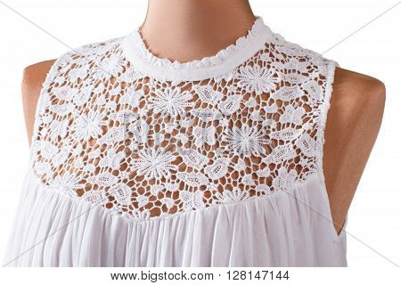 Sleeveless top with lace insert. Sleeveless top on beige mannequin. Girl's white clothing for summer. Lightness and style.