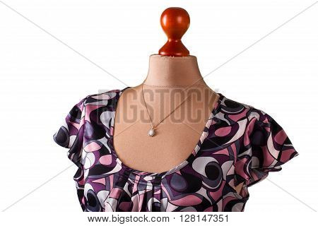 Casual blouse and small pendant. Blouse with pendant on mannequin. Lady's dark colorful u-neck top. Custom made necklace in studio.
