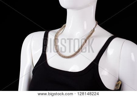Black sleeveless dress with necklace. White female mannequin wearing necklace. Lady's silver jewelry on sale. Precious handmade accessory.