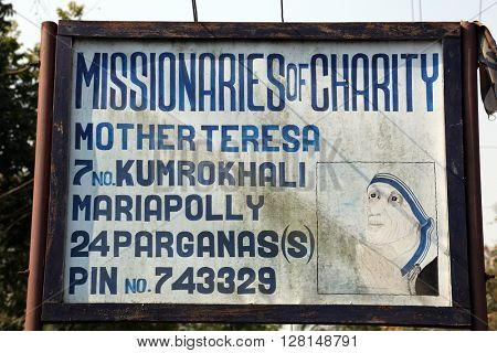 KUMROKHALI, INDIA - FEBRUARY 13: The inscription at the entrance in one of the houses established by Mother Teresa and run by the Missionaries of Charity in Kumrokhali, West Bengal, India Feb 13,2014.