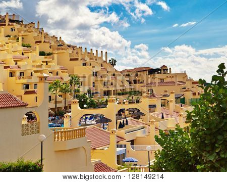 TENERIFE ISLAND, SPAIN - OCTOBER 28, 2015 : View on the unknown apartment complex in Adeje town in the south of Tenerife, the largest island of the Canary Islands