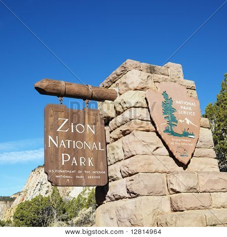 Wooden and stone sign for Zion National Park, Utah.