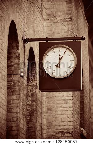 Urban historical architecture with vintage clock in street in London.