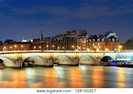 River Seine and Pont Neuf at night in Paris, France.