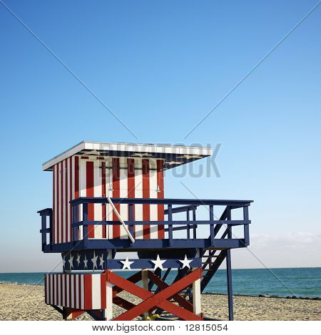 Lifeguard tower painted red, white and blue with stars and stripes on beach in Miami, Florida, USA.