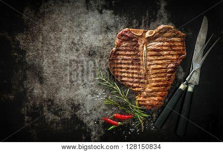 Grilled T-Bone Steak on dark background