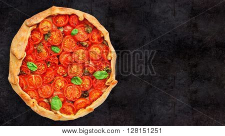 Cherry tomato tart on a black background