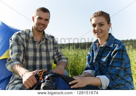 Couple camping in the forest