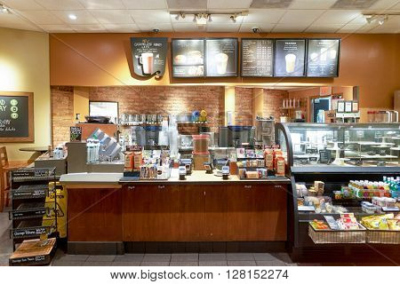 CHICAGO, IL - CIRCA MARCH, 2016: sales area in Starbucks Cafe. Starbucks Corporation is an American global coffee company and coffeehouse chain based in Seattle, Washington