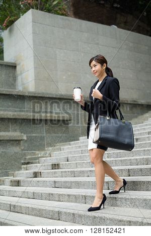 Business woman walking on stairs