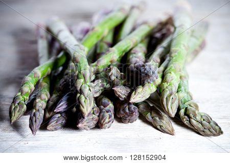 fresh asparagus closeup on wooden table