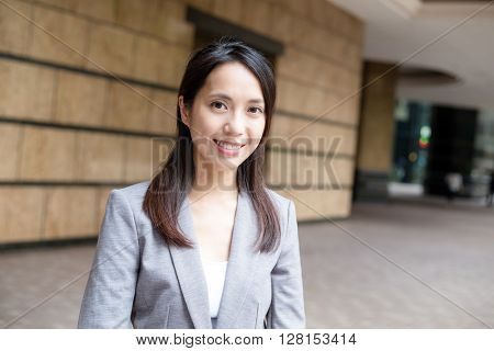 Smiling young business woman on