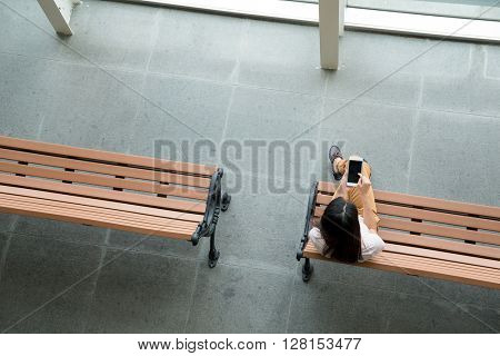 Top view of woman hold a smart phone