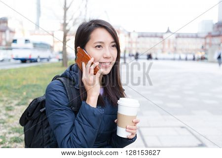 Woman talk to cellphone at outdoor