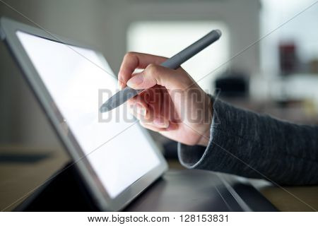 Woman write on tablet pc