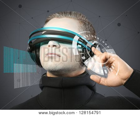 Man with futuristic glasses - future concept