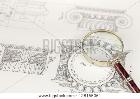 magnifying glass & architectural drawing
