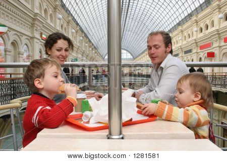Family In Cafe In Big Shop