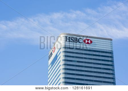 LONDON, UK - MAY 1, 2016: Cropped shot of Canary Wharf HSBC bank skyscraper against blue sky. Canary Wharf is London's second financial district.
