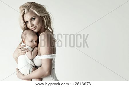Adorable blonde mom and baby