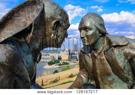 PITTSBURGH, PENNYSLVANIA - AUGUST 8, 2012: The Point of View sculpture at Point of View Park. The statue depicts George Washington and the Seneca leader Guyasuta.