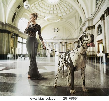Fashion type photo of a stylish woman with a dog