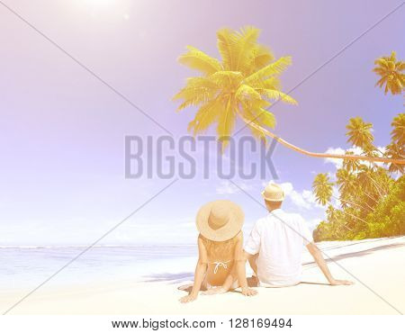 Love Couple sitting at the beach.