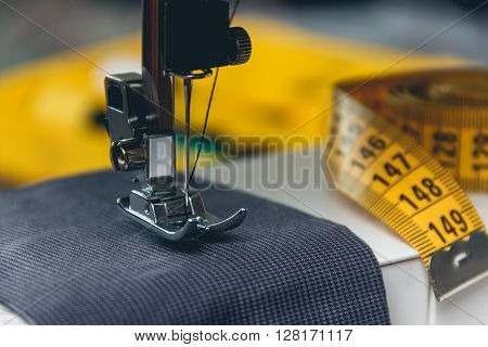 sewing machine and item of clothing. close up