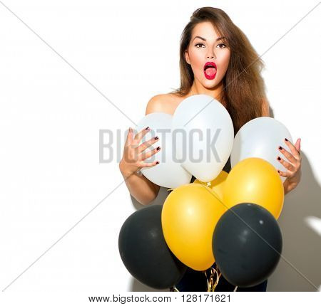 Beautiful fashion model girl with colorful balloons posing isolated on white background. Beauty surprised funny girl. Model holiday selebrating, posing in studio with balloons. Holiday party concept