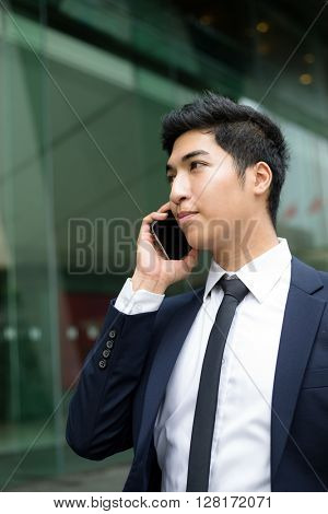 Indian businessman talking on phone