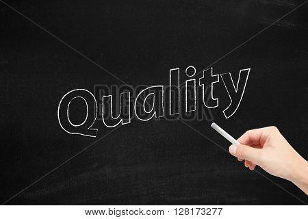 Quality written on a blackboard