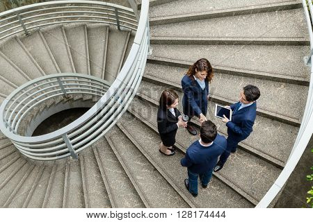 Top view of business people standing at the steps