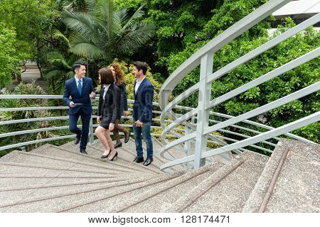 Business people walking up to staircase