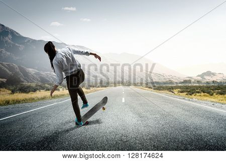 Girl ride skateboard