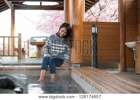 Woman treatment of feet by hot spring