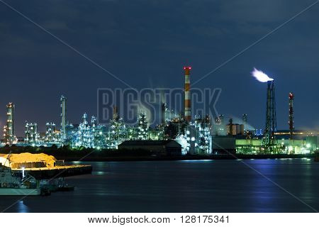 Oil and gas refinery at night