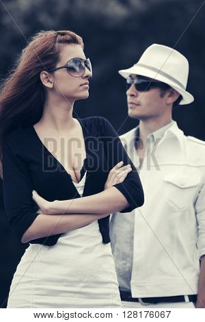 Young couple in conflict outdoor. Male and female fashion model