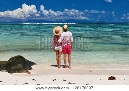 Couple on a tropical beach at Seychelles