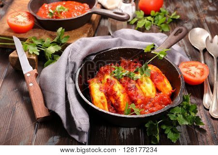 quenelle with tomato sauce