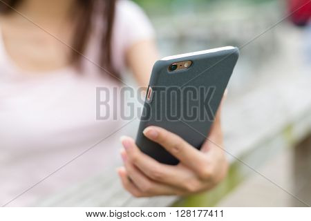 Woman hand hold and touch smart phone