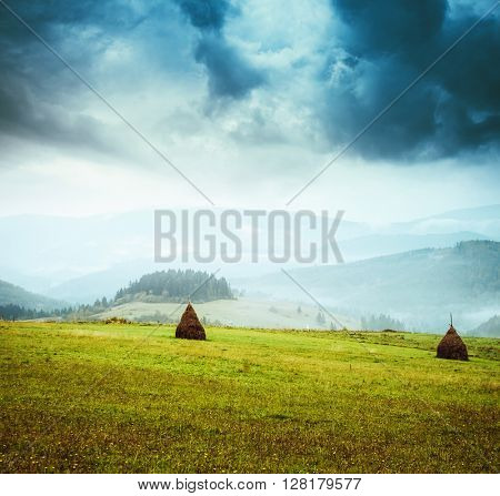 Great view of the green hills which glowing by sunlight. Dramatic scene and picturesque picture. Location place Swiss alps, Europe. Beauty world. Retro and vintage style. Instagram toning effect.