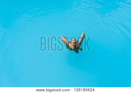 Woman at the swimming pool top view